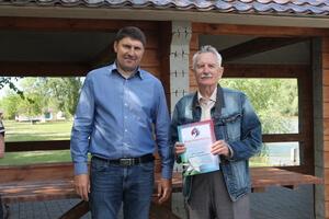 Директор заповедника Николай Цымляский и старейший работник заповедника, орнитолог Герман Русанов